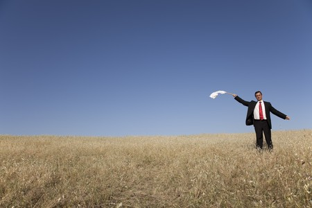 businessman asking for surrendering with a white flag photo