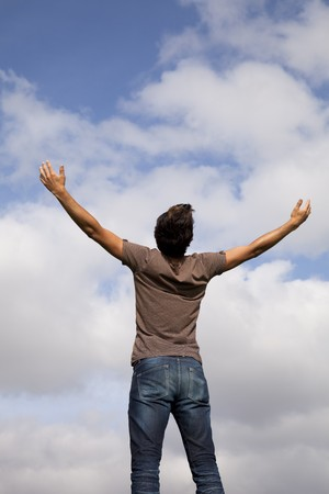 arms outstretched: young teenager with the arms outstretched in outdoor Stock Photo