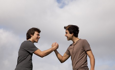 two person only: two teenager doing a special handshake Stock Photo