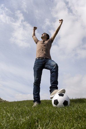 Young men celebrating a soccer goal Stock Photo