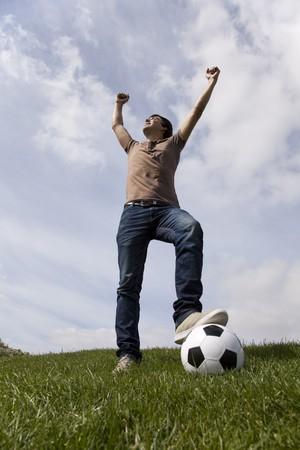 Young men celebrating a soccer goal Stock Photo - 7812078