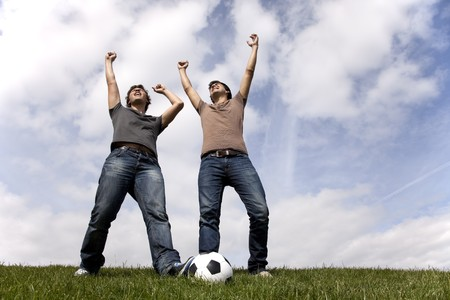 Two young men celebrating a goal from there soccer team photo