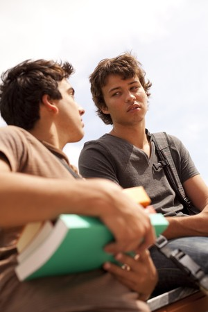 two young student talking at the school (selective focus) Stock Photo - 7810267