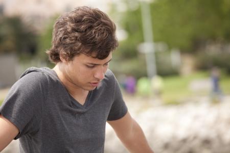 sad teenager looking down in outdoor Stock Photo - 7812131