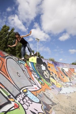 cool skateboard woman at a public graffiti park photo