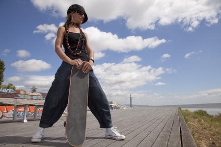 cool skateboard woman in outdoor photo