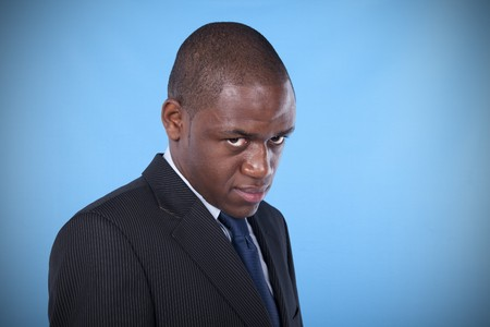 african businessman with a evil and powerful look photo