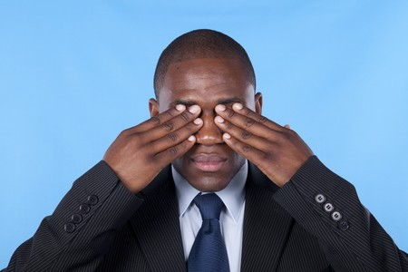african businessman with hands covering his eyes Stock Photo - 7812226