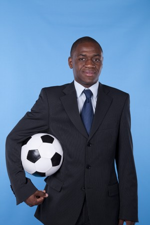 African businessman holding a soccer ball Stock Photo - 7812144