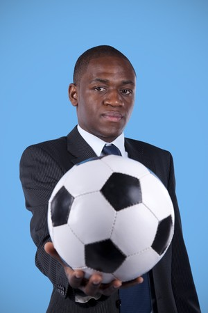 African businessman holding a soccer ball photo