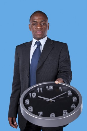 african businessman holding an office clock photo