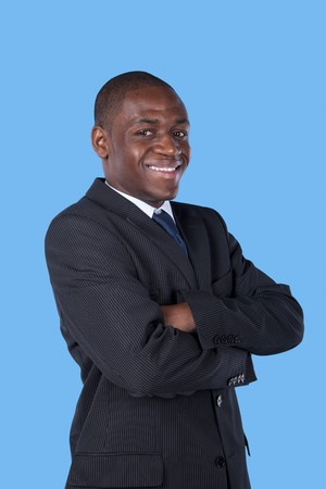 African businessman smiling to you (with blue background) photo