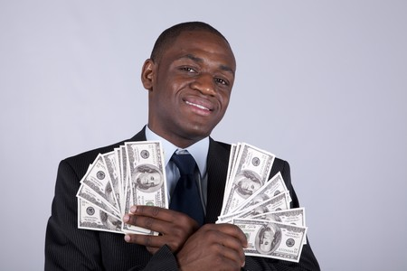 Successful and wealthy african businessman showing you money  photo