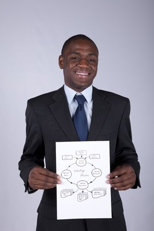 Happy african businessman showing a strategy process diagram photo
