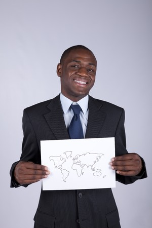 african businessman holding a world map diagram photo