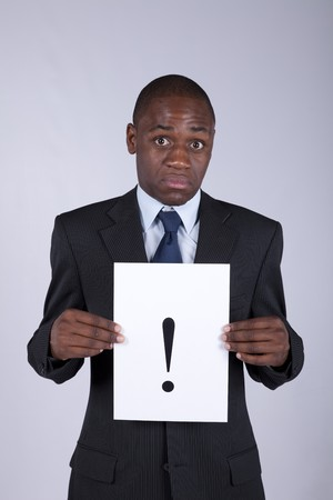 African businessman with a big exclamation point photo