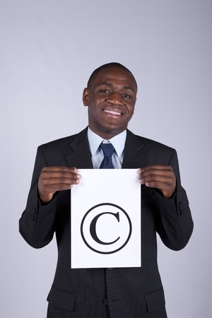 african lawyer businessman holding a copyright symbol photo