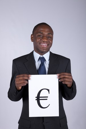 african businessman holding the european currency symbol (euro) photo