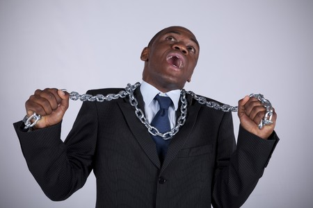 Powerful african businessman with a steel chain in his hands photo
