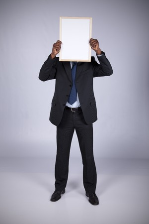 african businessman holding a blank whiteboard Stock Photo - 7810783