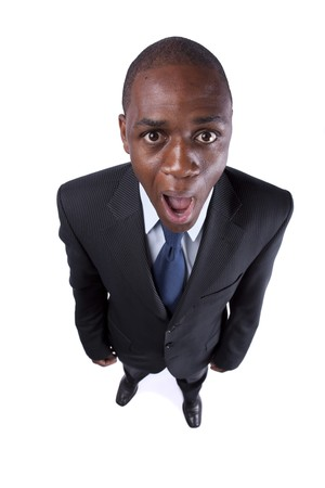 African businessman screaming with a strange face expression and open mouth (isolated on white) Stock Photo - 7810704