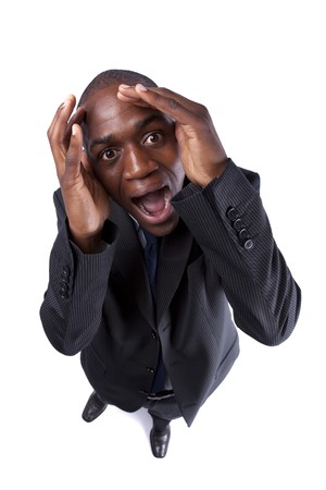 African businessman screaming with fear and a strange face expression (isolated on white) Stock Photo - 7812081