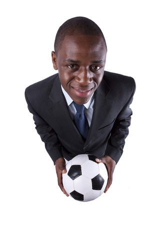 African businessman holding a soccer ball (isolated on white) photo
