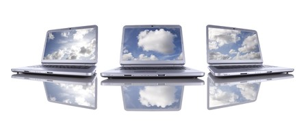 computer cloud: Cloud computing concept in three modern laptop isolated on white Stock Photo