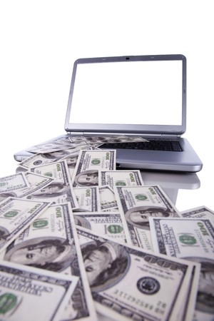 Laptop with lots od money, spending or making money concept (with copy space) photo