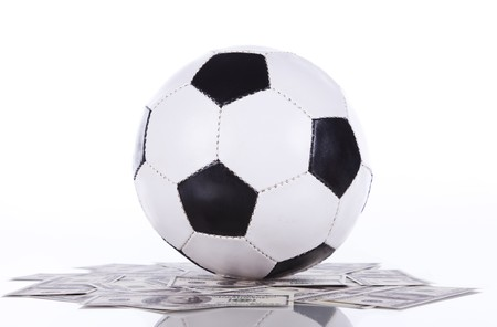 soccer ball over a lot of money (selective focus) Stock Photo - 7810262