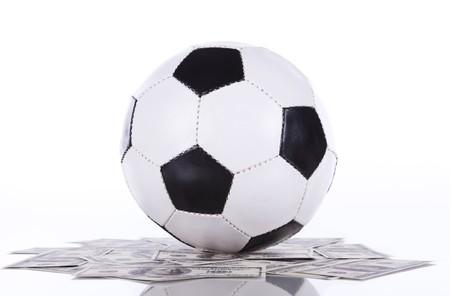 soccer ball over a lot of money (selective focus) photo