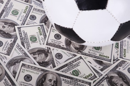soccer ball over a lot of money (selective focus) Stock Photo - 7812239