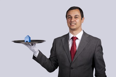 happy businessman showing you house services solutions Stock Photo - 7812122
