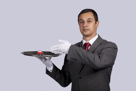happy businessman showing you car services solutions Stock Photo - 7810771
