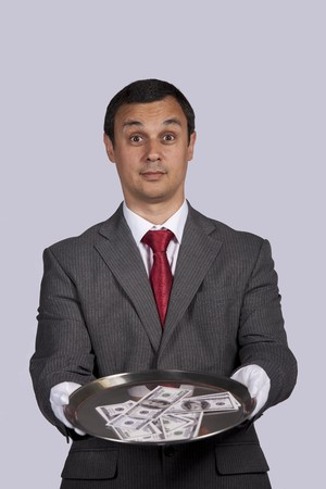 businessman serving you money on a plate photo