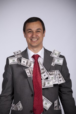 Happy and rich businessman showing all his money photo