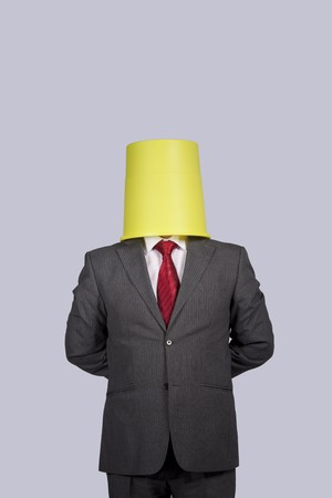 businessman with a bucket on his head Stock Photo - 7810638