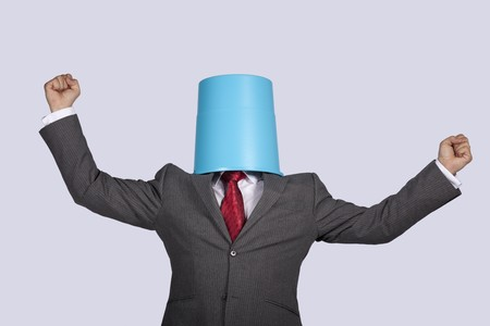 successful businessman with a bucket on his head Stock Photo - 7810775