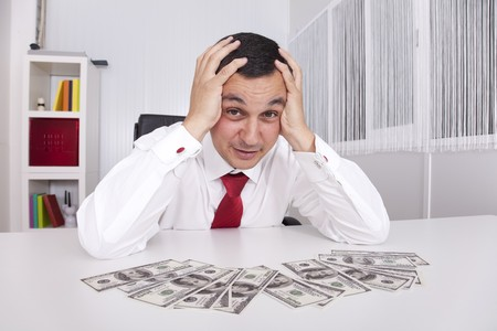 Businessman at the office enjoying his money photo