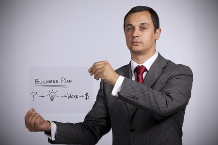 Businessman with a strategy plan to be successful in his business (selective focus) photo