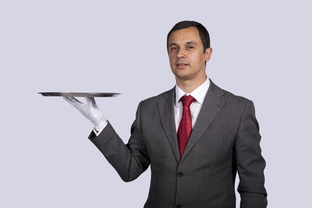 businessman showing you a solution (copyspace over the tray) photo
