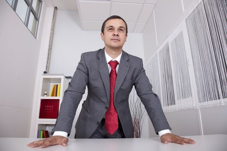 Modern and powerful businessman at his office photo