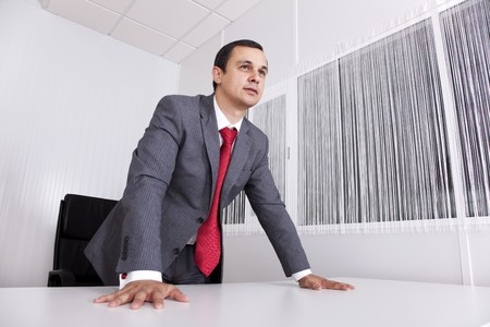 Modern and powerful businessman at his office Stock Photo - 7812238