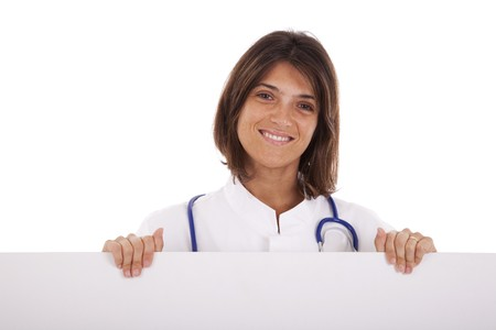 friendly woman doctor pointing to the copy space in a banner (isolated on white) photo