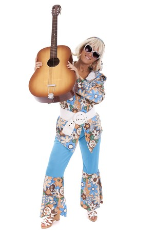 happy young hippie woman holding a guitar (isolated on white) photo