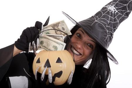 stealing money: halloween witch saving money on her pumpkin