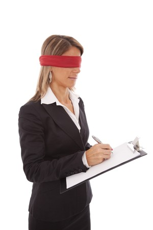 business ethics: blindfold businesswoman signing a contract (isolated on white) Stock Photo