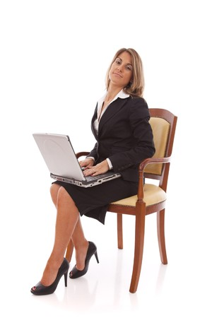 Businesswoman working with her laptop (isolated on white) photo