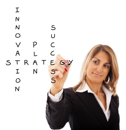 Businesswoman solving a strategy plan to be successful in her business photo