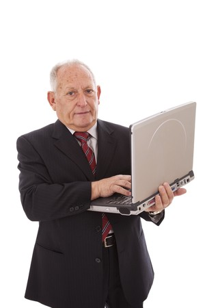 senior businessman working with a laptop (isolated on white) photo
